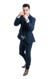 Manager entrepreneur or broker fighting position. With fists ready to punch isolated on white background Stock Photo
