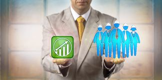 Manager Equating Blue Collar Team With Growth. Unrecognizable HR manager equating blue collar worker team of five with a potential growth icon. Business concept royalty free stock photography