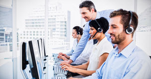 Manager and executives with headsets using computers royalty free stock photos