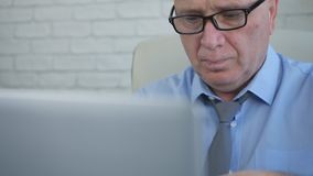 Manager with Eyeglasses Working on Laptop stock images
