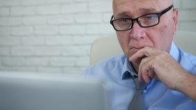 Manager with eyeglasses working with laptop in company office stock video