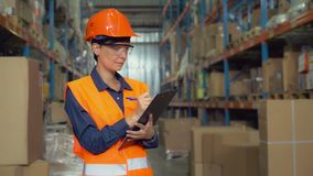 Portrait employee at work in storehouse. stock photography