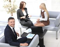 Manager Finance working with documents on the background of colleagues. Business concept Royalty Free Stock Photography