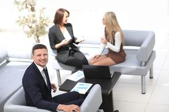 Manager Finance working with documents on the background of colleagues. Business concept Stock Photography