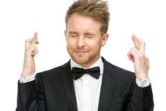 Manager with fingers crossed and eyes closed Royalty Free Stock Photos