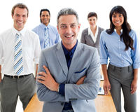 Manager with folded arms in front of his team Royalty Free Stock Photos