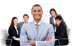 Manager with folded arms in front on his team Stock Photography