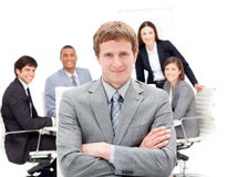 Manager with folded arms in front on his team Royalty Free Stock Photography