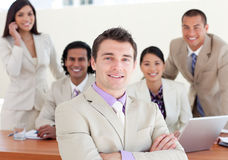 Manager with folded arms in front of his team Royalty Free Stock Image