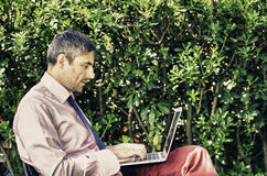 Manager in the Garden with his Notebook Stock Images