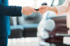 manager giving car key to customer stock photography