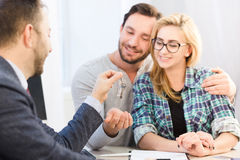 Manager giving key to couple royalty free stock images