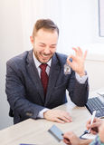 Manager giving key to couple stock images