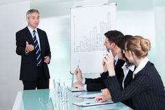 Manager giving a presentation to staff Royalty Free Stock Photos
