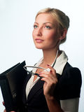 Manager with glasses and a folder. Female manager with glasses and a folder for documents on a light background Royalty Free Stock Photos