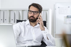 Manager with glasses on the phone Stock Images