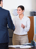 Manager greeting new employee Stock Image
