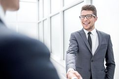 Manager greets the client with a handshake. royalty free stock image
