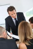 Manager guiding business team Royalty Free Stock Photo