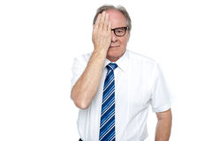 Manager with hand on right eye looking at you Stock Image