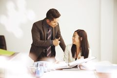 Manager hand thumb up for secretary consult for working. In the office desk Stock Image