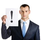 Manager hands paper with exclamation mark Stock Photo