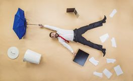 Manager has an accident. Handsome manager has an accident. Funny pose in studio Royalty Free Stock Photo