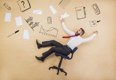Manager has an accident. Handsome manager has an accident. Funny pose in studio Stock Photos