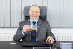 Manager having a coffee break. Picture of a thoughtful manager having a coffee break at the office royalty free stock photography