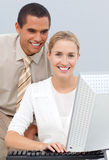 Manager helping a businesswoman with her computer Royalty Free Stock Image