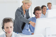 Manager helping call centre employee Stock Photography