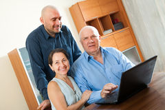 Manager helping to senior couple Stock Photo