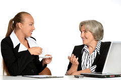 Manager and her elderly customer Royalty Free Stock Photo