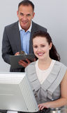 Manager and his employee smiling at the camera Stock Images