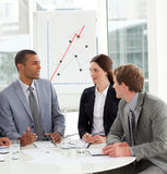 Manager and his team discussing a new strategy Royalty Free Stock Photo