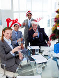 Manager and his team toasting with Champagne. At a Christmas party in the office Stock Image