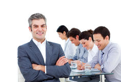 Manager and his team writting notes in a meeting Stock Photo