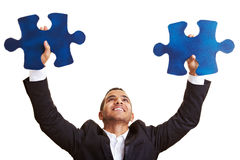 Manager holding big jigsaw pieces Stock Image