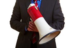 Manager holding big megaphone. Senior businessman holding a big megaphone in his hand Stock Image
