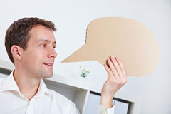 Manager holding comic speech Royalty Free Stock Images