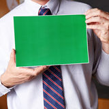 Manager holding green sign Royalty Free Stock Image
