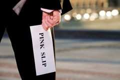 Manager holding a job termination notice Pink Slip Royalty Free Stock Image