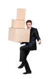 Manager holding pile of cardboard boxes Royalty Free Stock Image