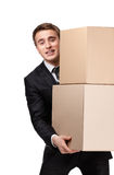 Manager holding pile of pasteboard boxes. Manager keeping pile of pasteboard boxes, isolated on white Stock Image