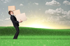 Manager holding pile of pasteboard boxes Stock Photos