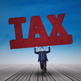Manager holding a sign of tax Royalty Free Stock Photo