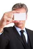 Manager holding white business card Royalty Free Stock Photography