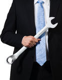 Manager holding wrench Royalty Free Stock Images