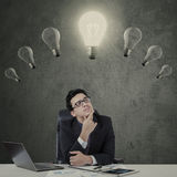 Manager with illuminated light bulb Royalty Free Stock Image
