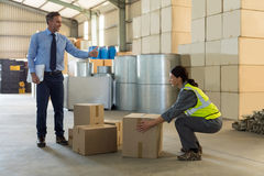Manager instructing female worker while working Stock Photos